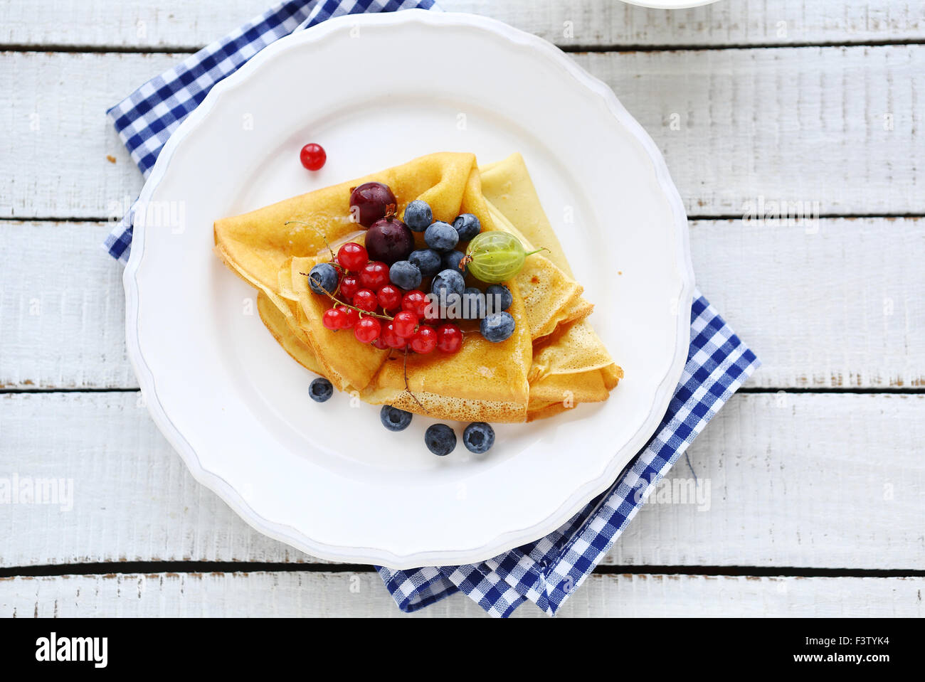 french crepes with berries, top view - Stock Image