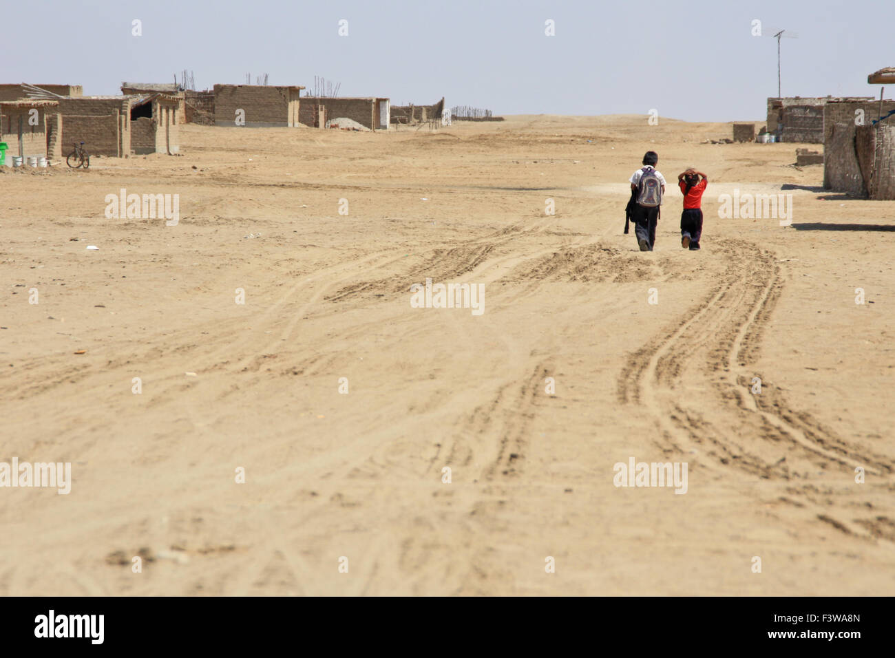 Schoolchildren in the desert Stock Photo