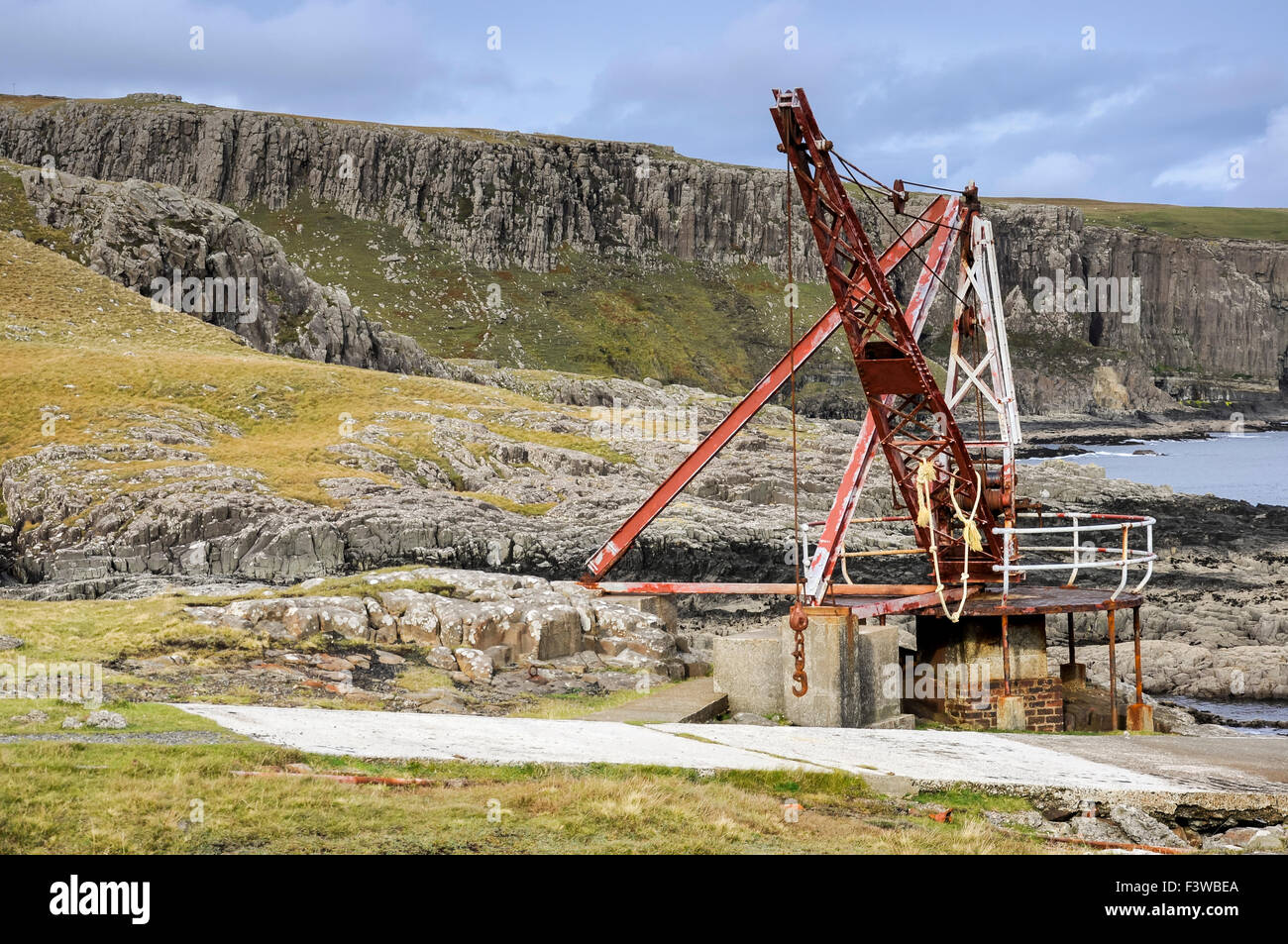 Old landing stage and crane at Neist Point on the Isle of Skye, Scotland. Stock Photo