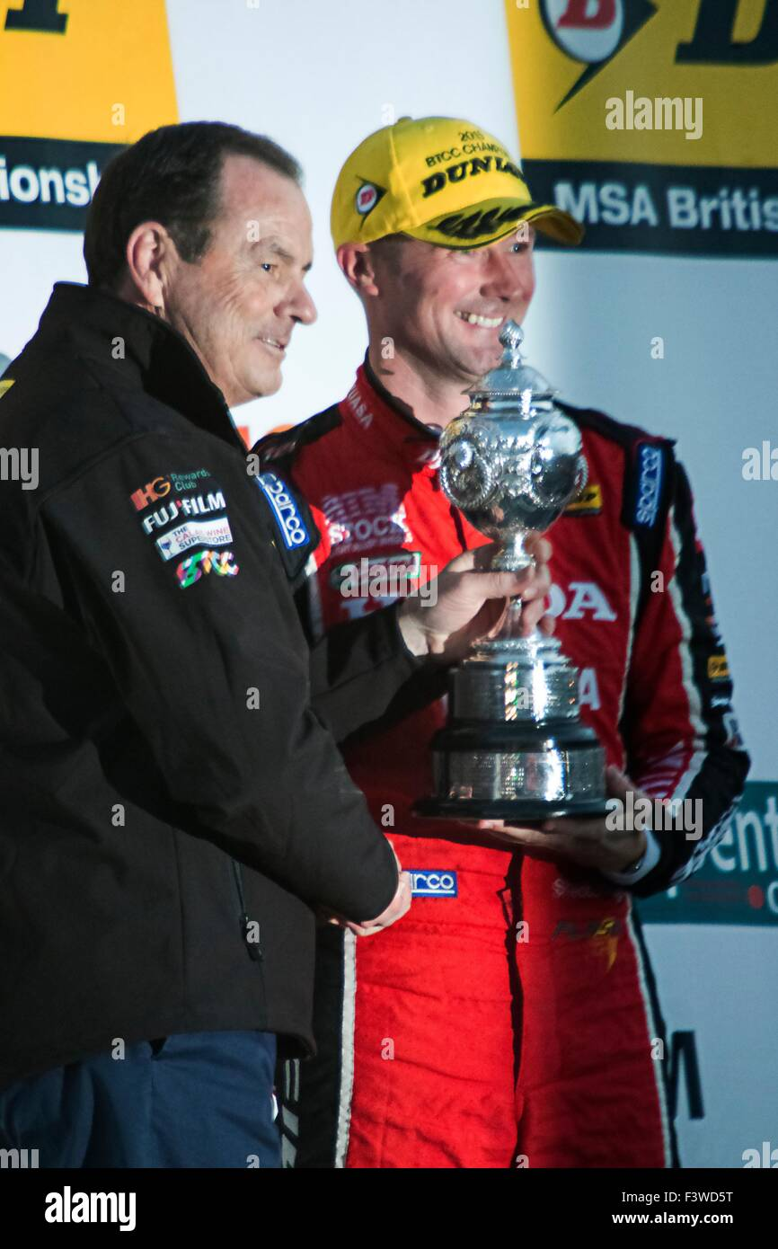 Gordon Shedden receiving his BTCC Championship trophy from Alan Gow at Brands Hatch - Stock Image