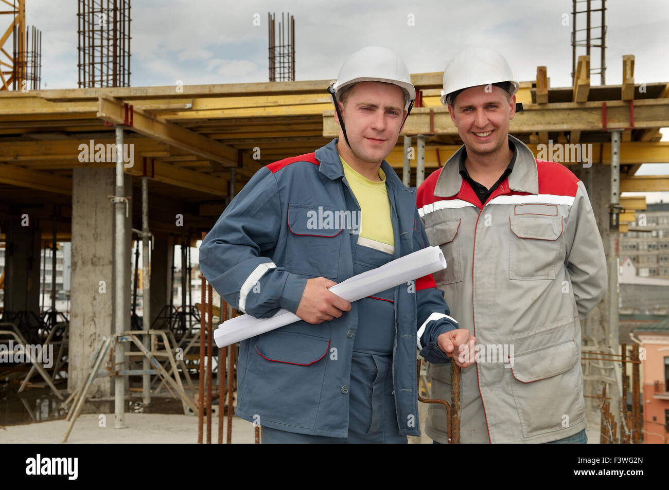 Engineers builders at construction site - Stock Image