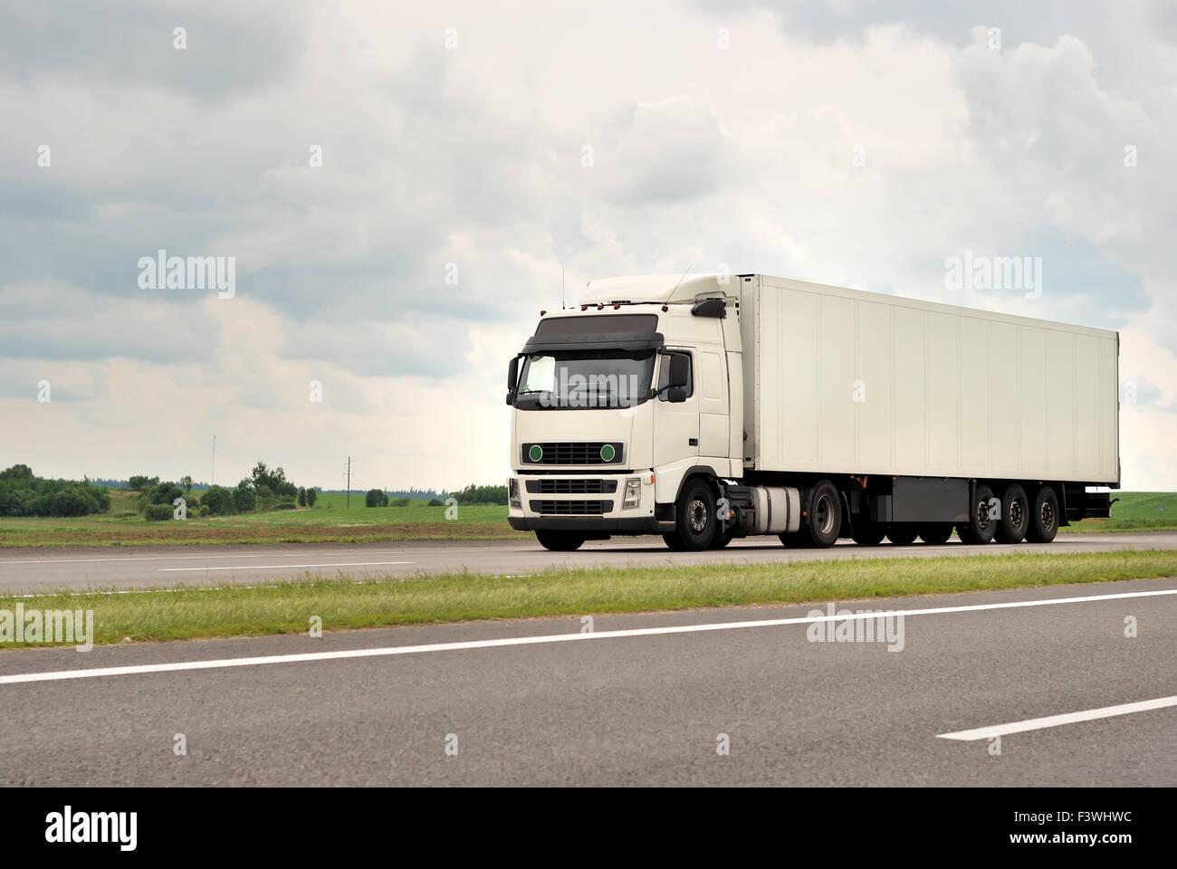 white truck on highway Stock Photo