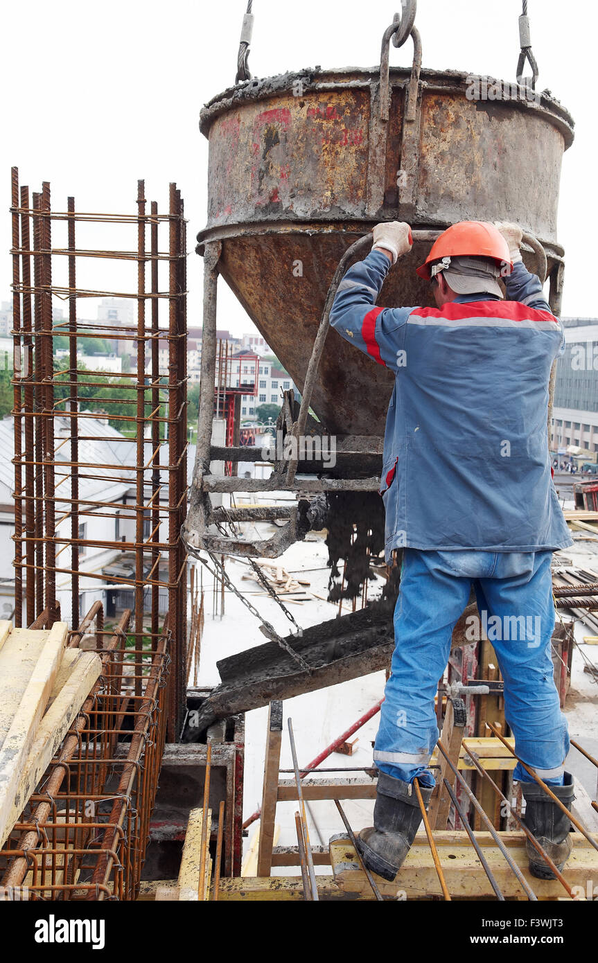 construction workers pouring concrete in form Stock Photo