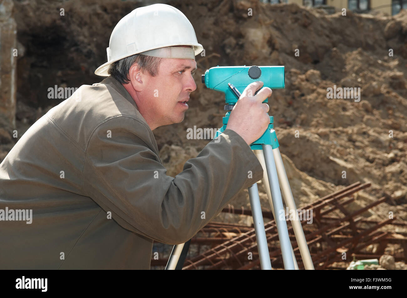 surveyor at construction work Stock Photo