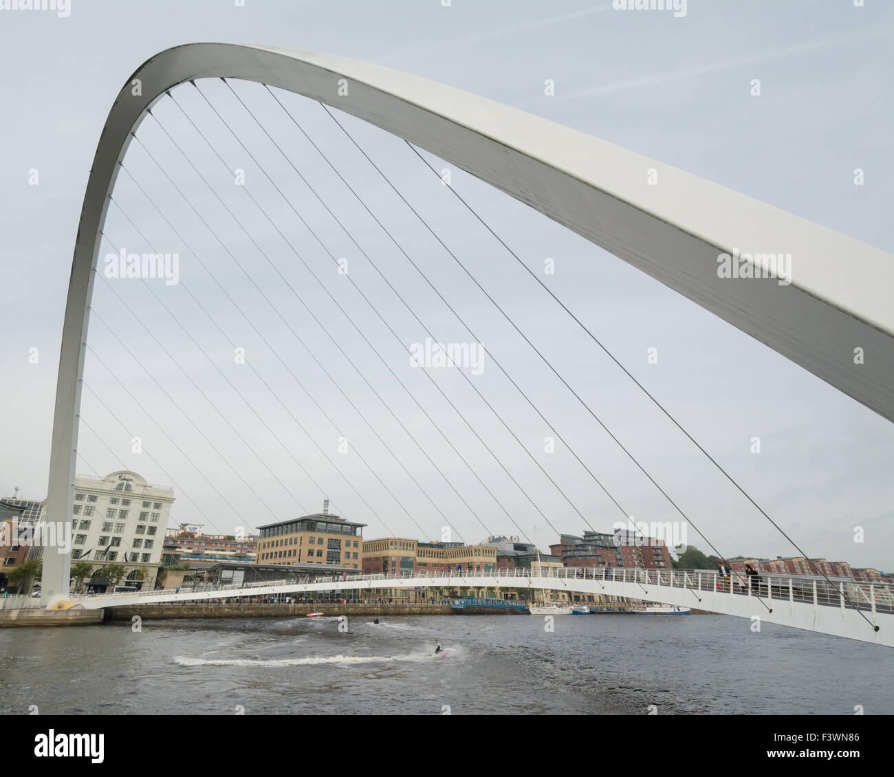 Jet skier passing under the Gateshead Millennium Bridge on the River Tyne - Stock Image