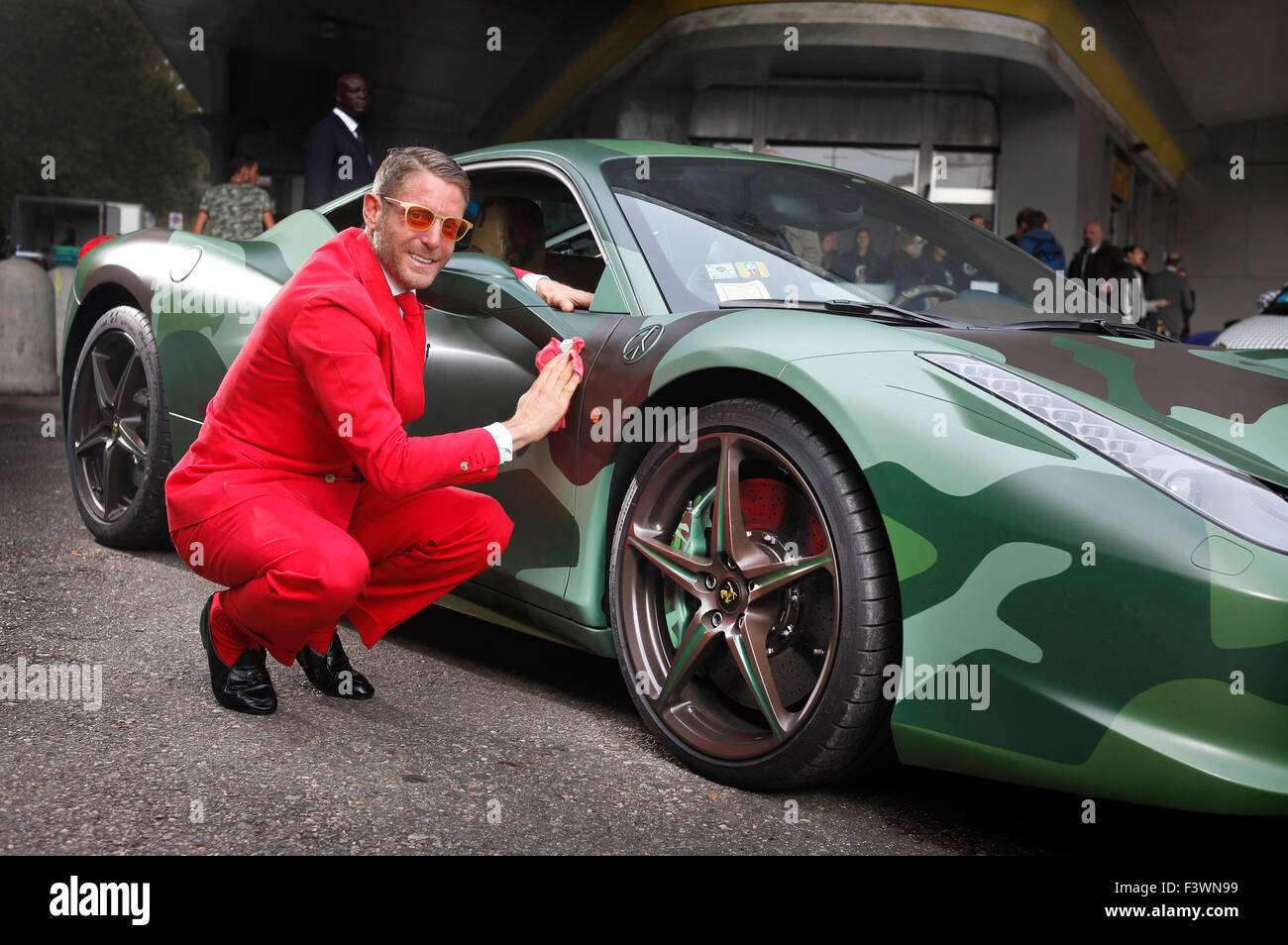 Lapo Elkann with a camoflauged Ferrari at the opening of the new headquarters of Garage Italia Customs in Milan, - Stock Image