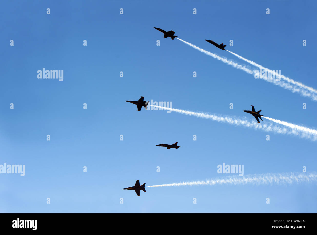 jet planes going off formation in the sky - Stock Image
