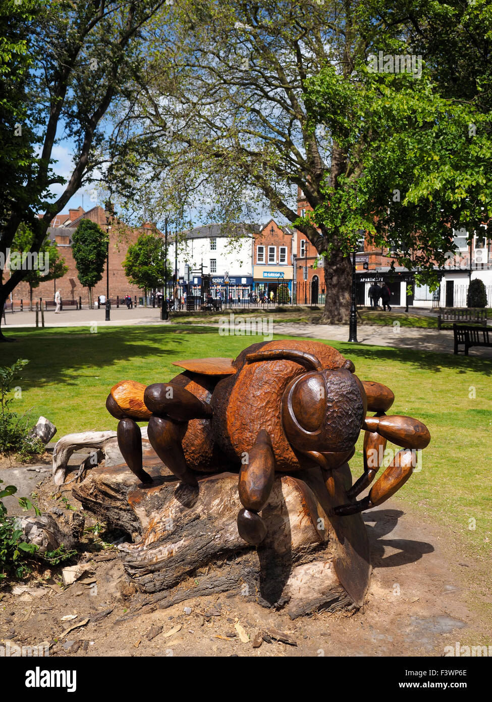 Wood carving of a bee Chesterfield Derbyshire - Stock Image