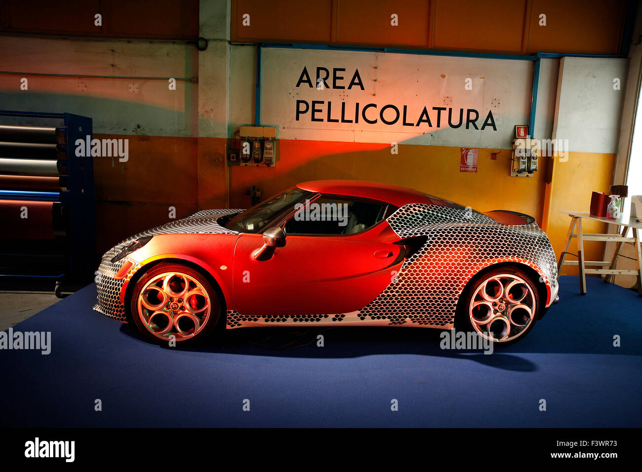 An Alfa Romeo 4C vinyl wrapped at the opening of the new headquarters of Garage Italia Custom in Milan, Italy. - Stock Image