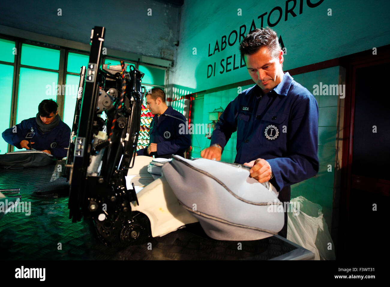 Custom upholstery being made at the opening of the new headquarters of Garage Italia Customs in Milan, Italy, on - Stock Image