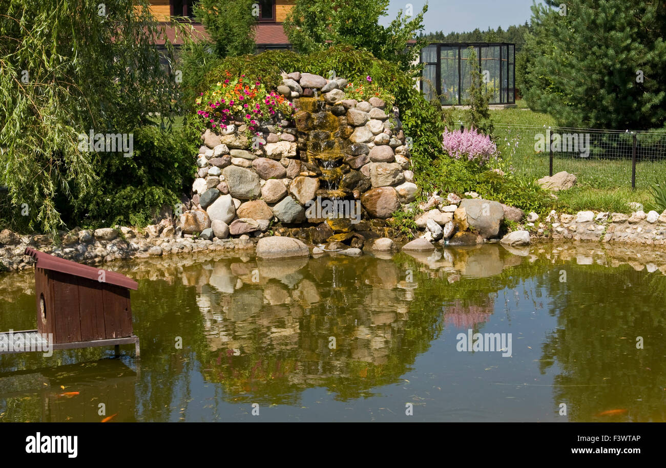 Example of landscape design - little artificial waterfall on little ...