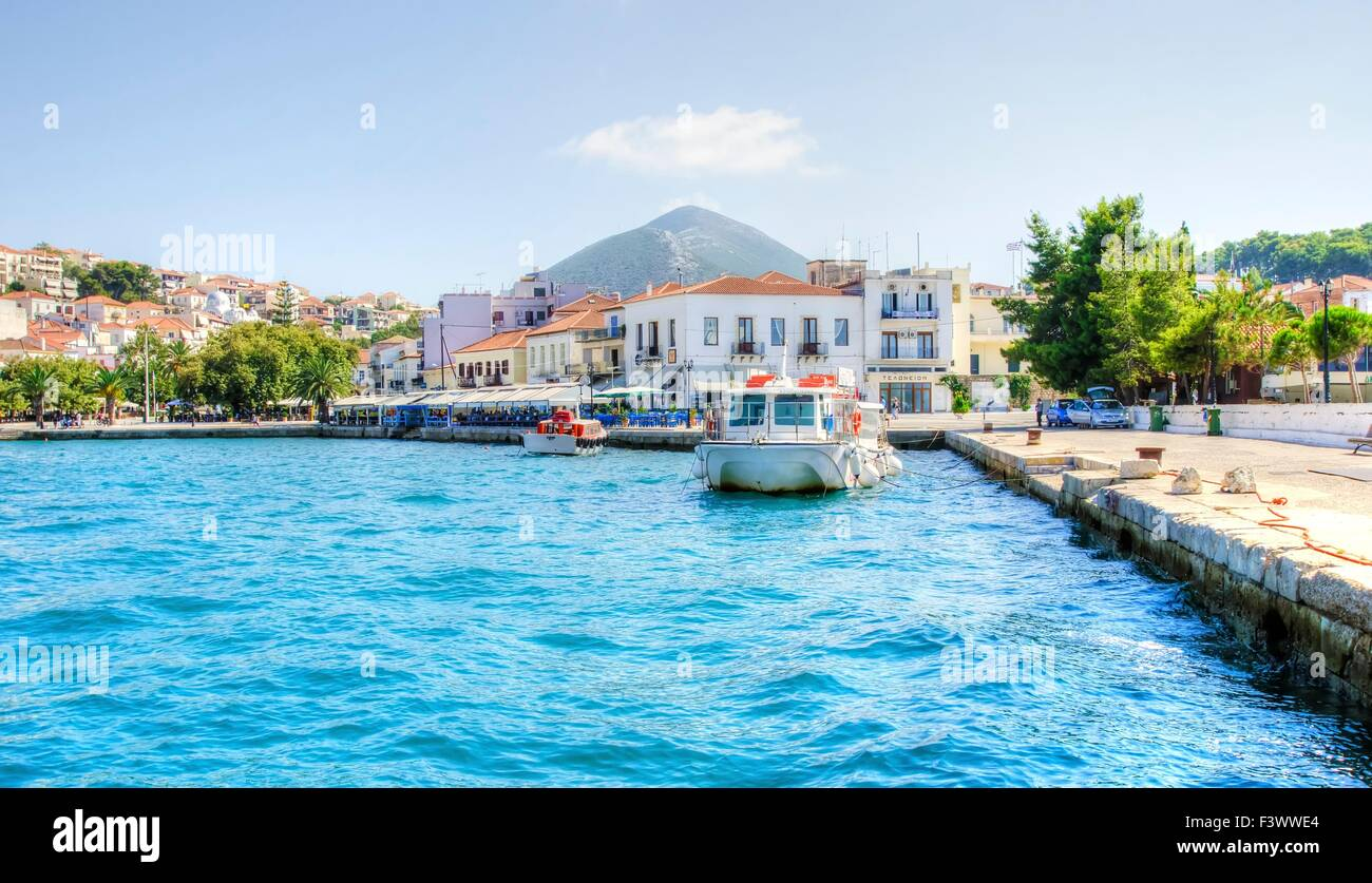 A view of the port of Pylos, a Greek city in Peloponnese (south Greece) and some local architecture in the background. - Stock Image
