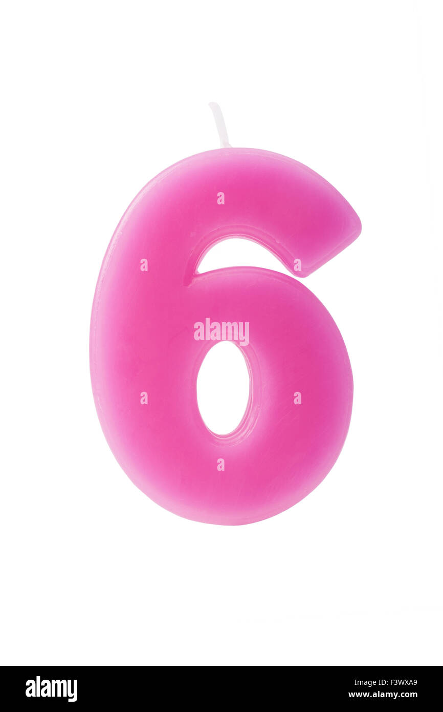 Pink birthday candle in the form of the number six on white background - Stock Image