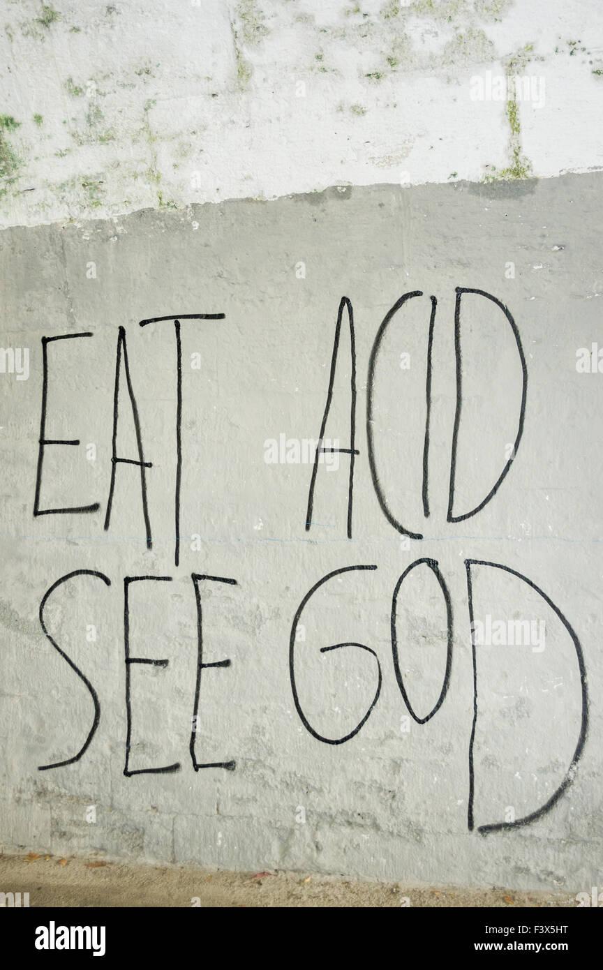 eat acid, see god Stock Photo