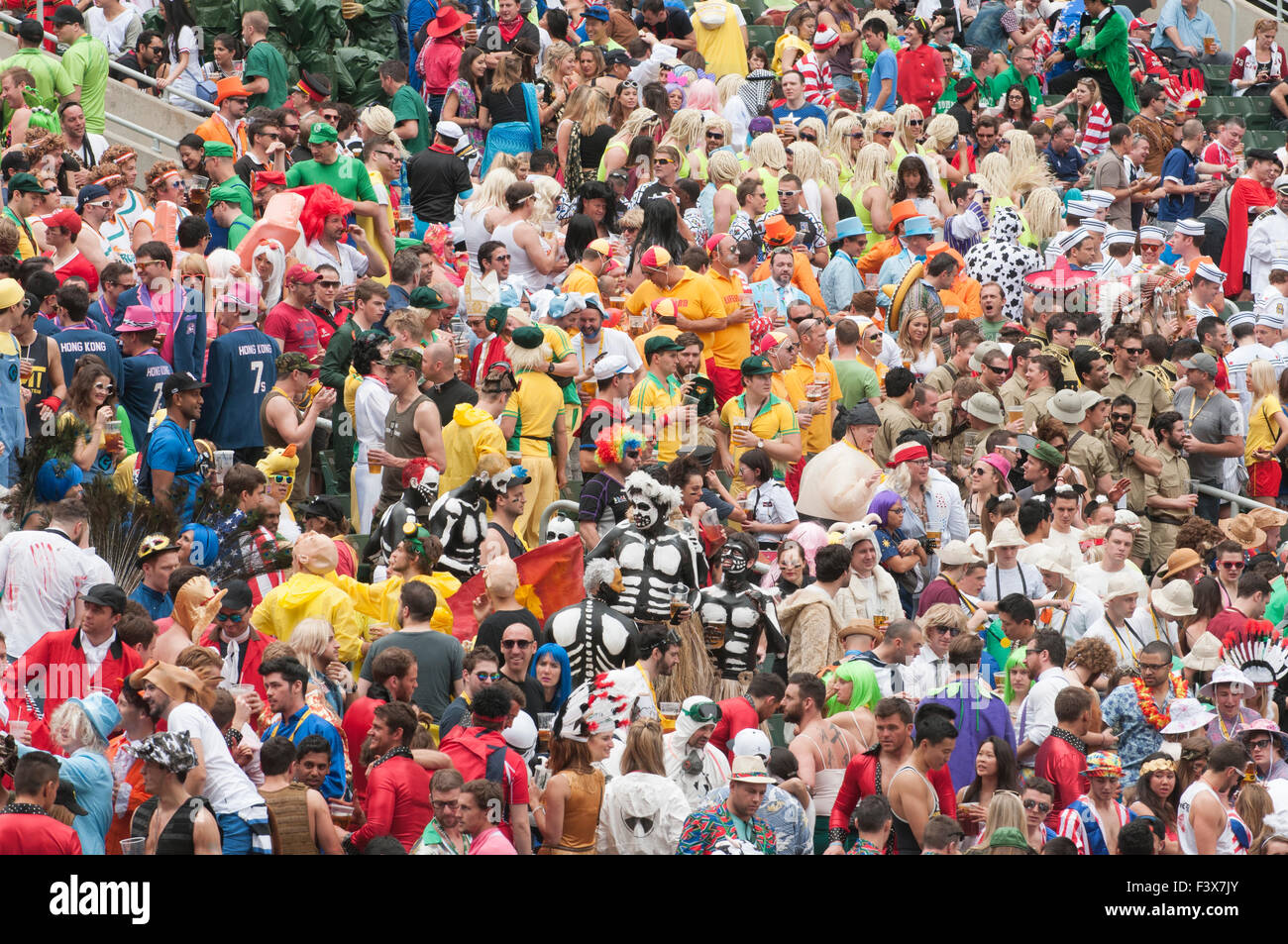 Crowds of fans wearing costumes in the south stand of Hong Kong Stadium Sevens Rugby event. Stock Photo