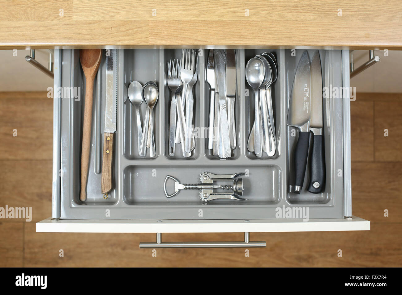 A kitchen drawer full of all the cutlery, knives and utensils needed to cook up a storm. - Stock Image