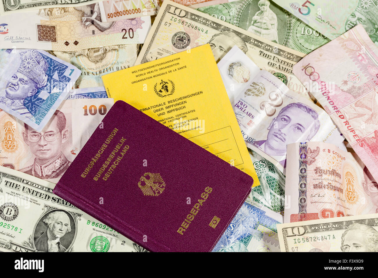 Currency and passport Stock Photo