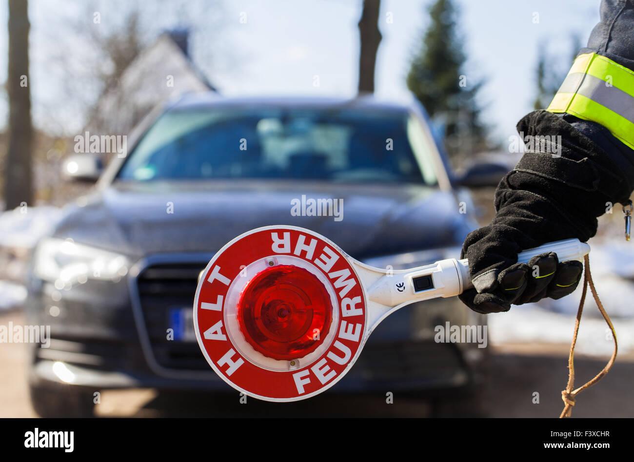 Firefighter fireman roadblock - Stock Image