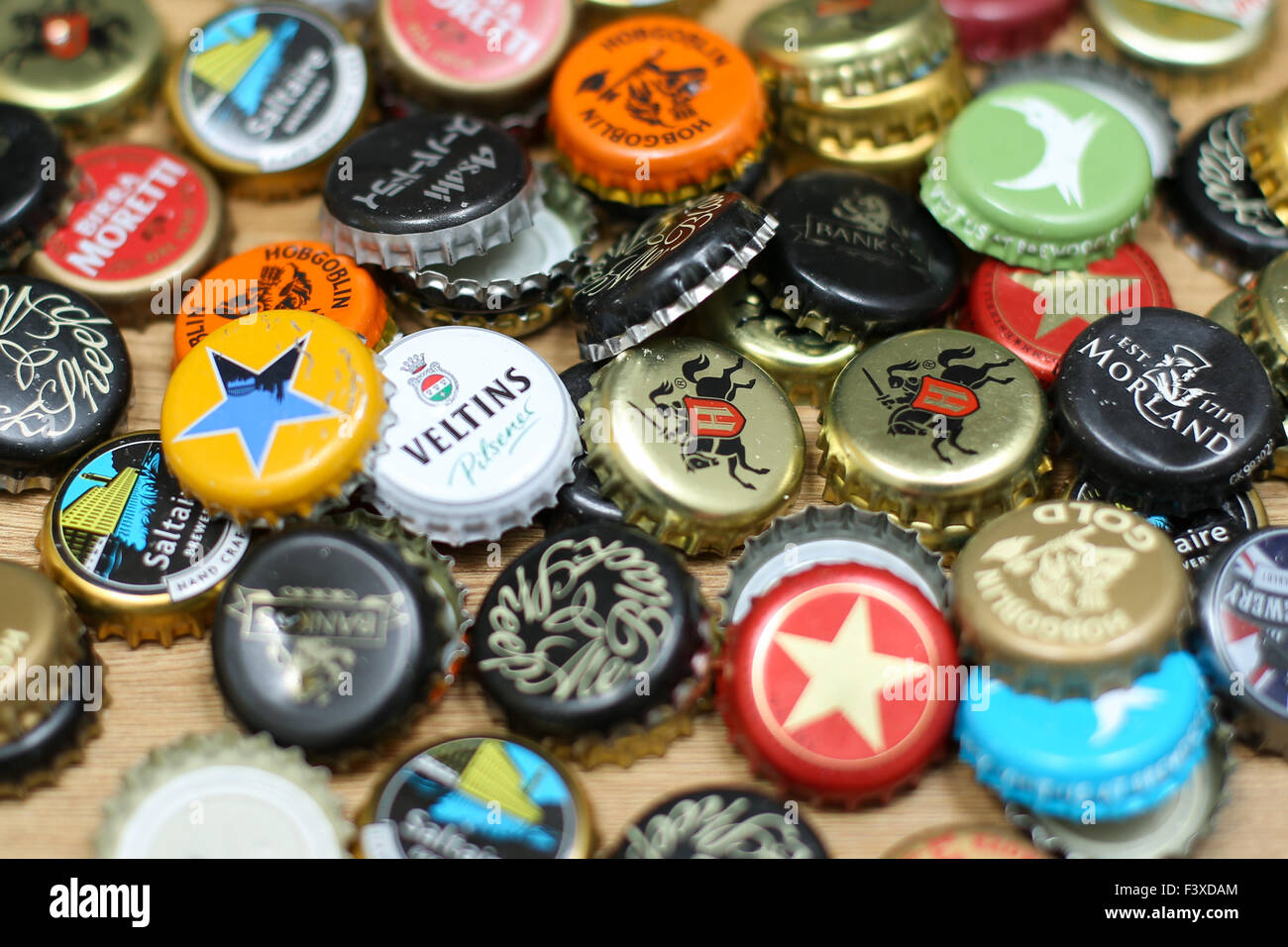 A collection of different caps from bottled beers. - Stock Image