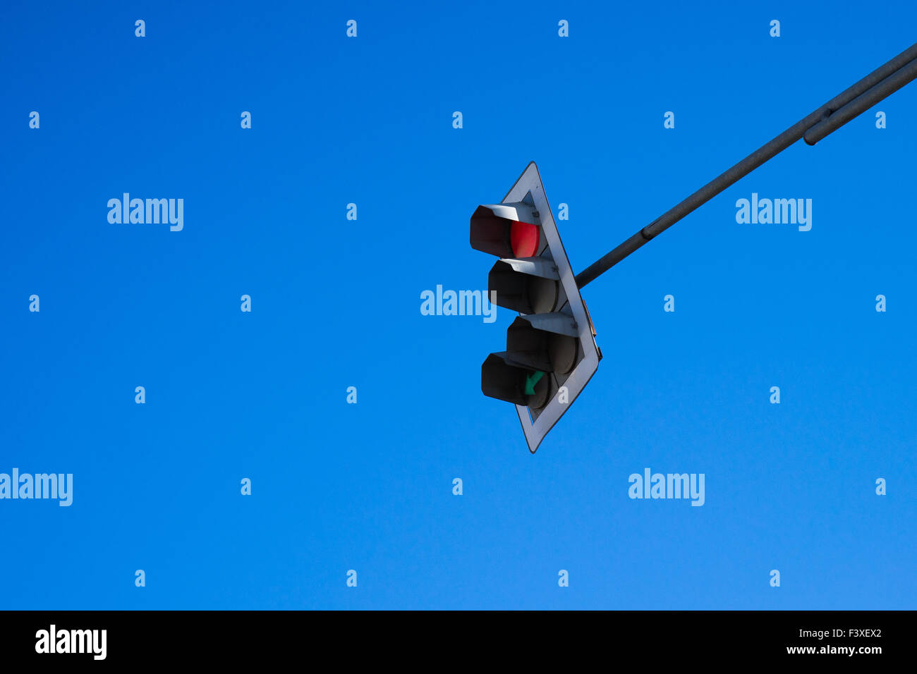 Traffic light. Red light and green arrow - Stock Image