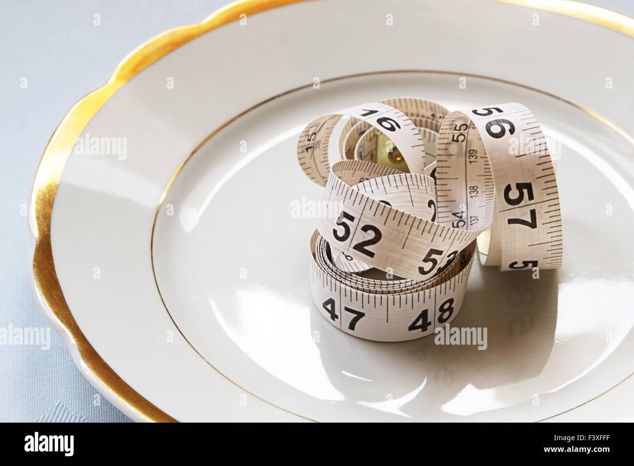 White centimeter on white chinaware Stock Photo
