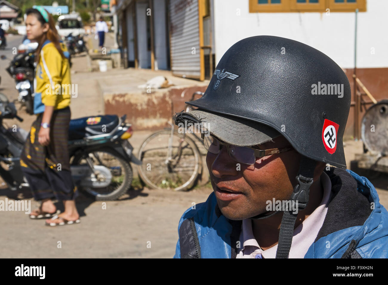 Moped Rider Wearing Helmet Of The Wehrmacht Stock Photo