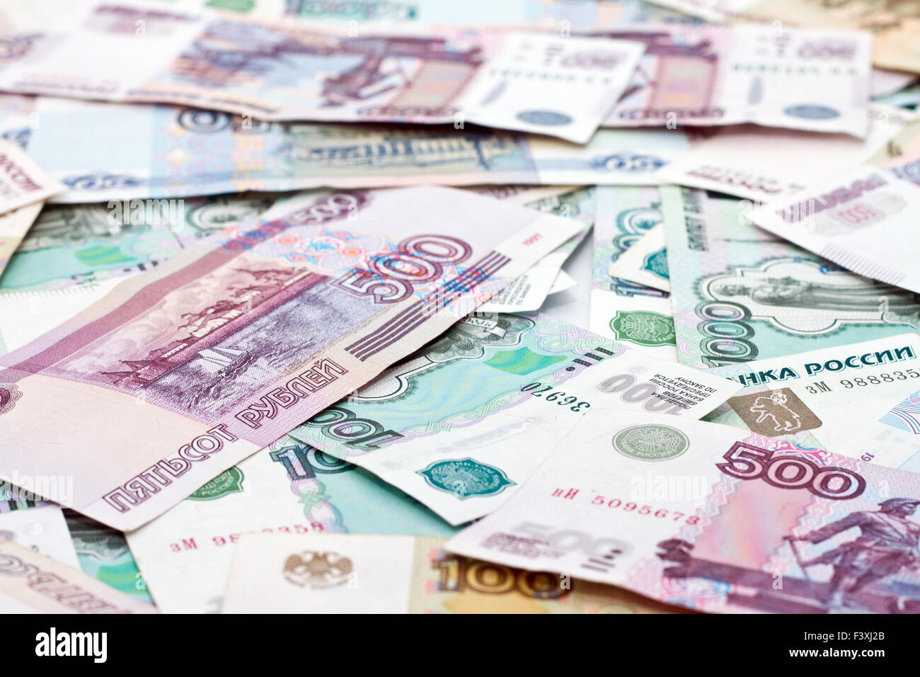 Money scattered on the floor Stock Photo