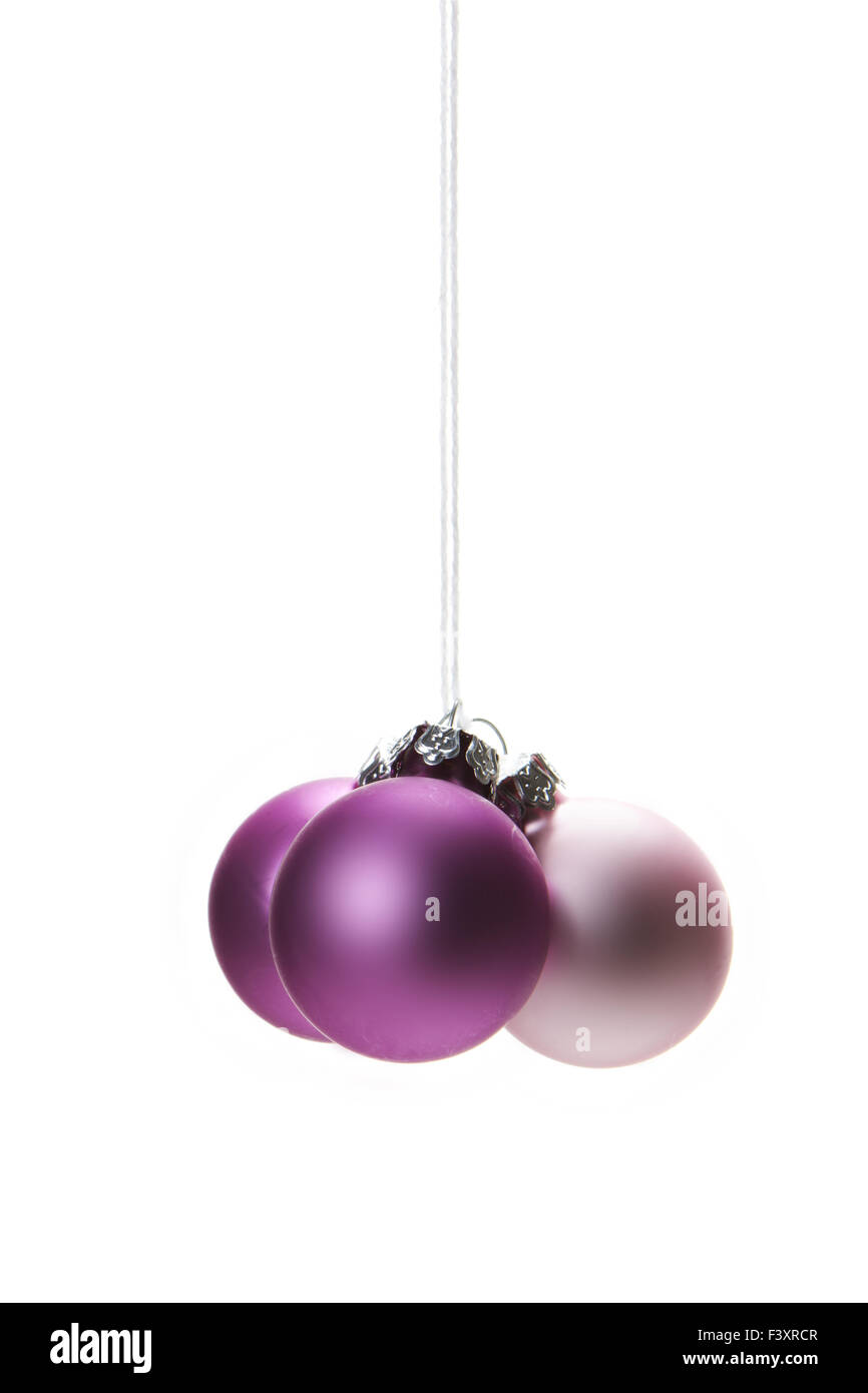 pink christmas balls isolated hanging - Stock Image
