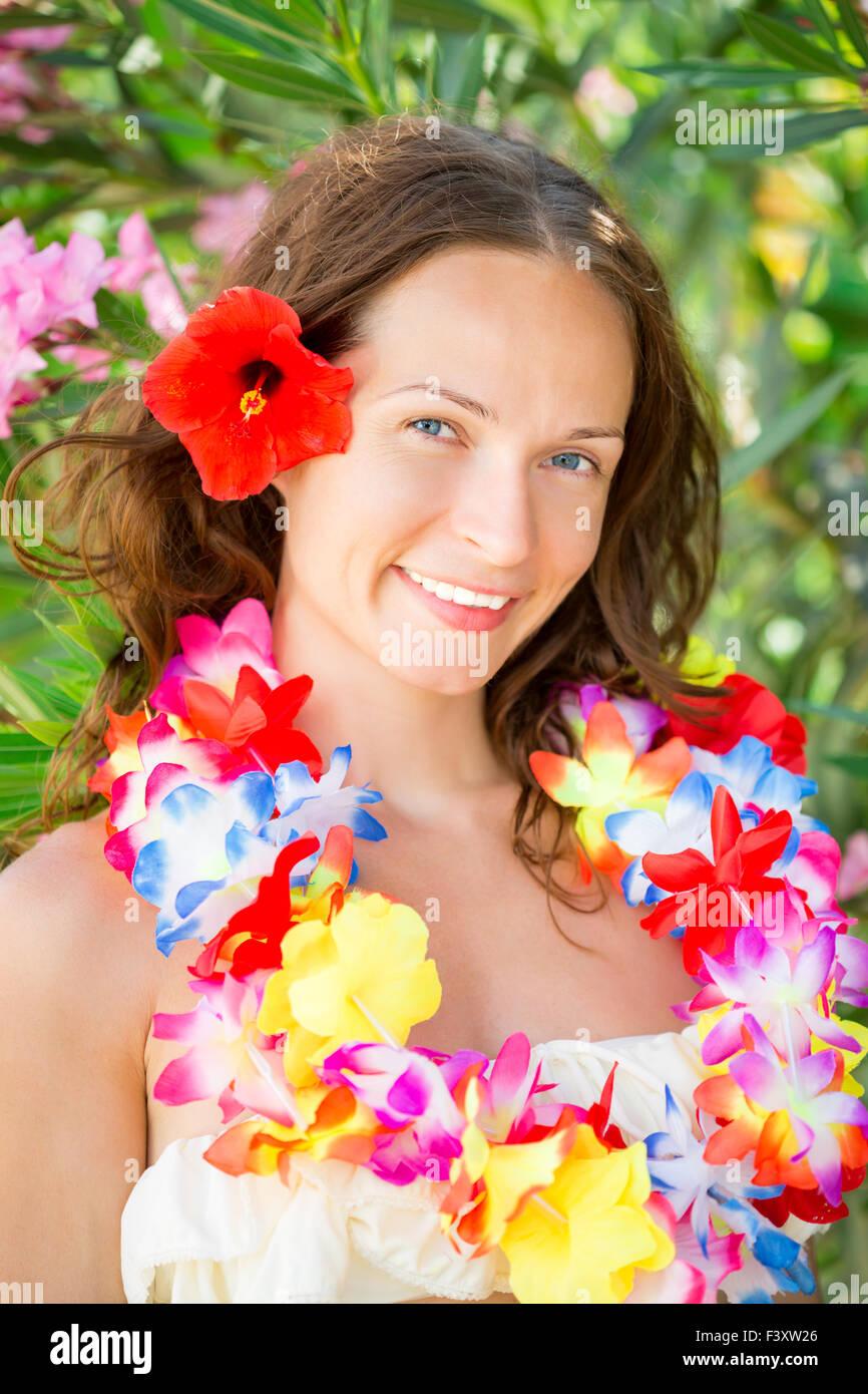 Hawaiian garland stock photos hawaiian garland stock images alamy woman in hawaiian flowers garland stock image izmirmasajfo