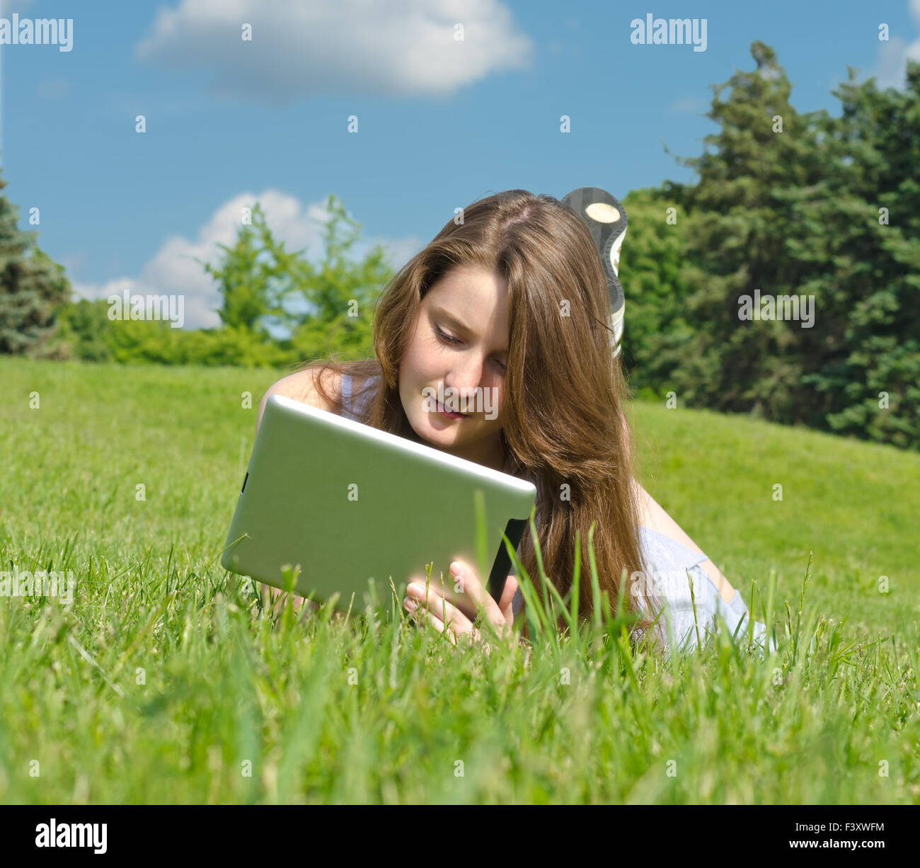 Young woman using touchpad - Stock Image