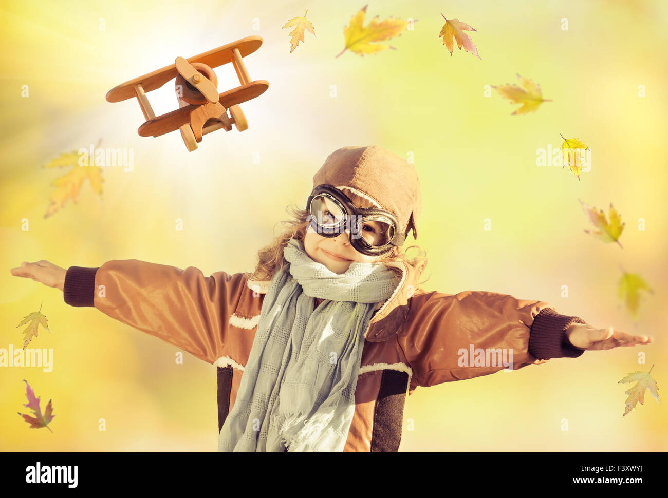 happy-kid-playing-with-toy-airplane-F3XW
