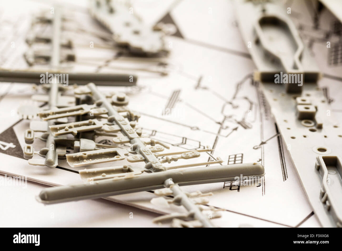 Plastic model kit. Airfix 1/600 scale model kit of second world war destroyer. Grey plastic parts connected to spur - Stock Image