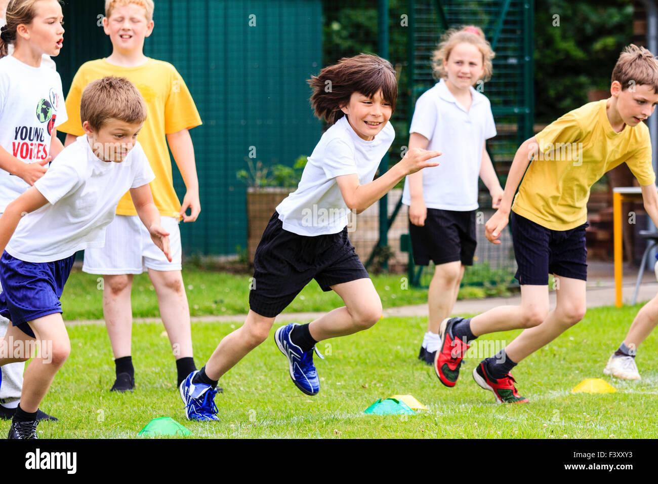England, school children, boys, 10-11 year old, running race on Stock Photo  - Alamy