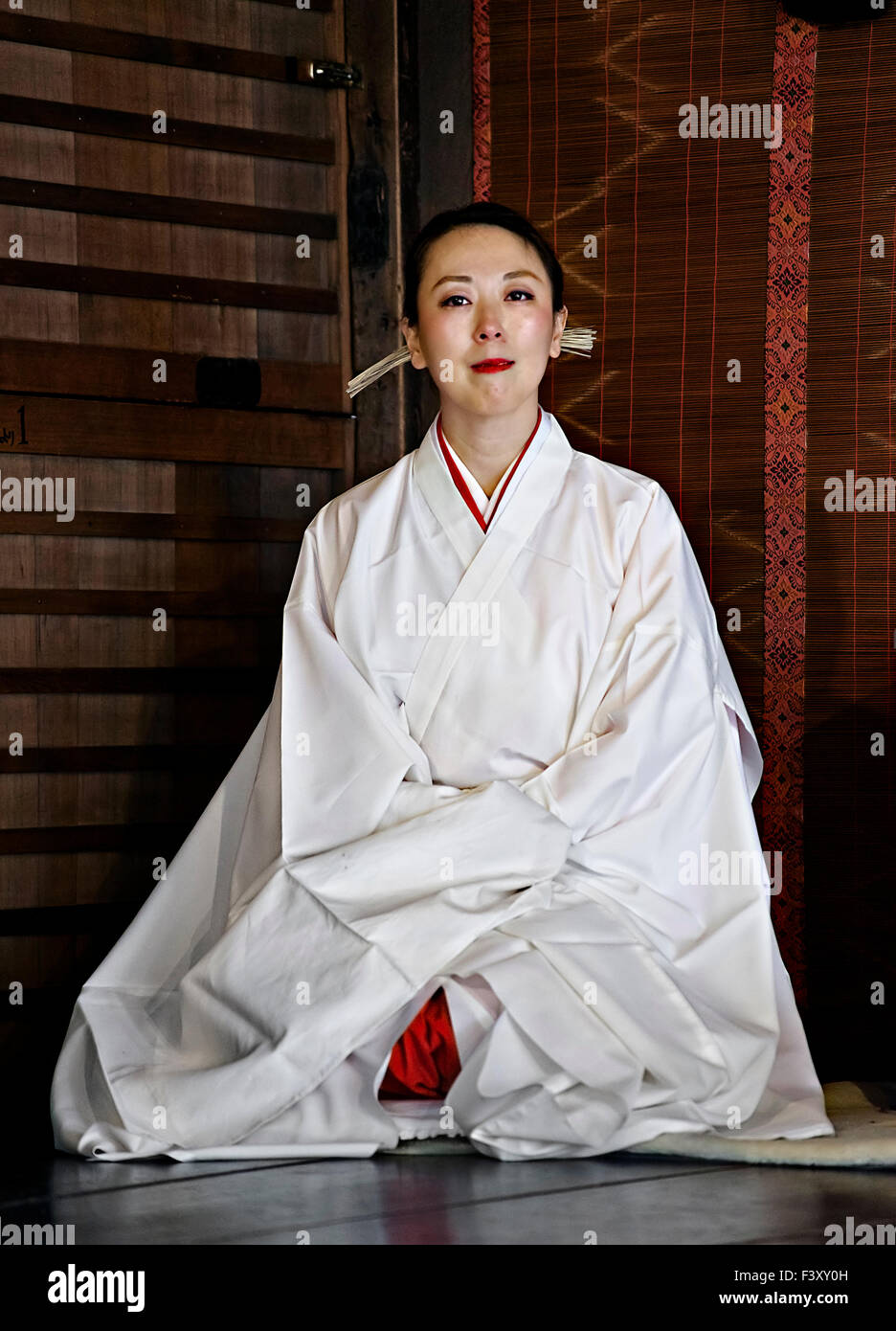Japan, Honshu island, Kansai, Kyoto, Woman priest called 'Miko'. - Stock Image
