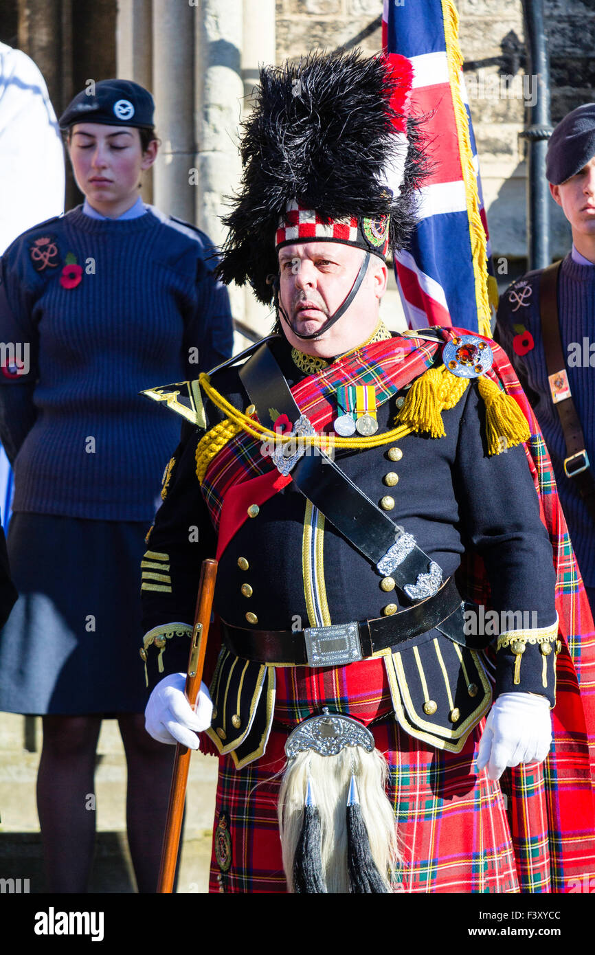 Remembrance Sunday Sergeant Major of the Scottish Highlanders in full dress uniform standing at attention outside - Stock Image