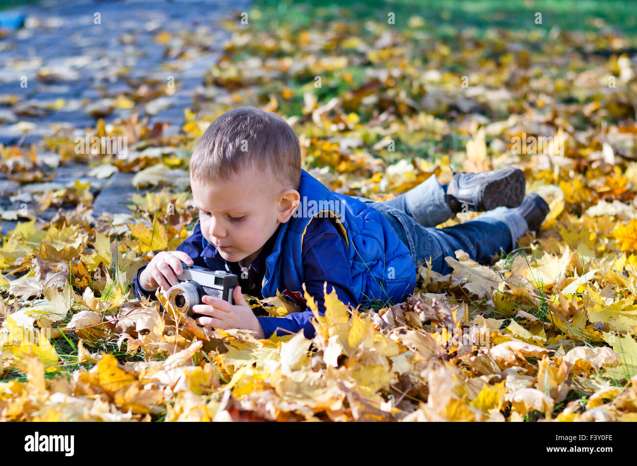 Small boy with a retro slr camera - Stock Image