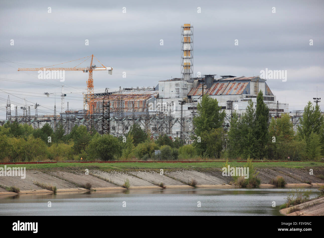 View on the (1986) destroyed reactor unit 4 with its enclosing sarcophagus. Chernobyl nuclear power plant. Chernobyl - Stock Image