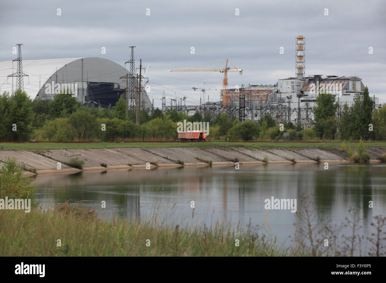 The Chernobyl nuclear power plant with the destroyed reactor no. 4 and the New Safe Confinement under construction. - Stock Image