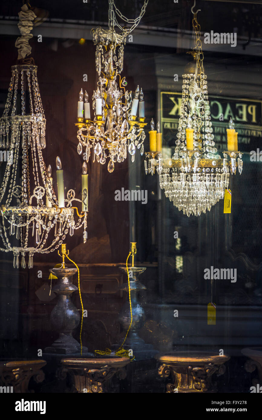 Window shopping beautiful crystal chandeliers hanging from ceiling window shopping beautiful crystal chandeliers hanging from ceiling of antique shop in the french quarter in new orleans la aloadofball Images