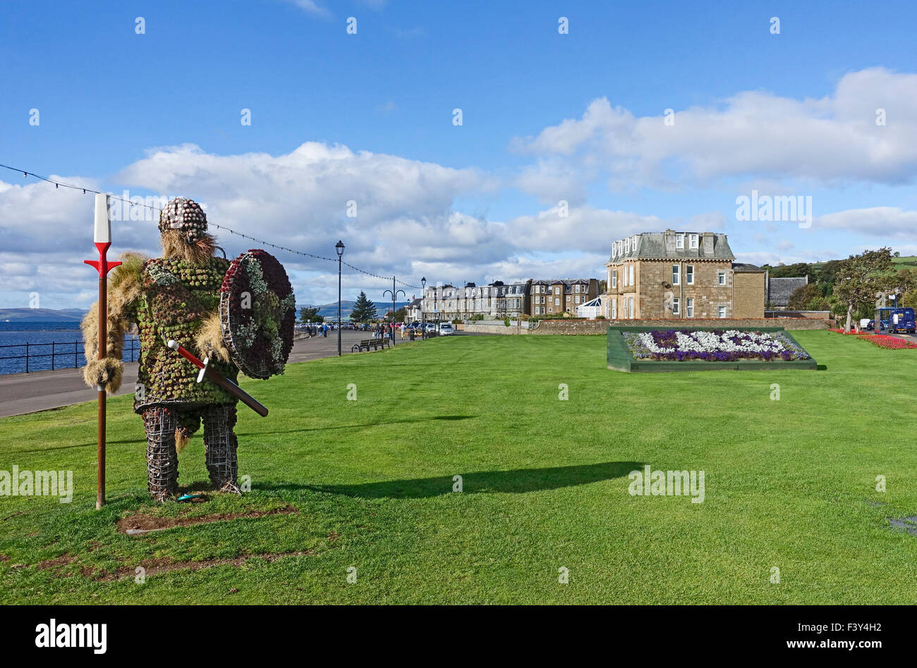 Statue of 'Magnus the Viking' made from flowers standing at the seafront in Largs North Ayrshire Scotland - Stock Image