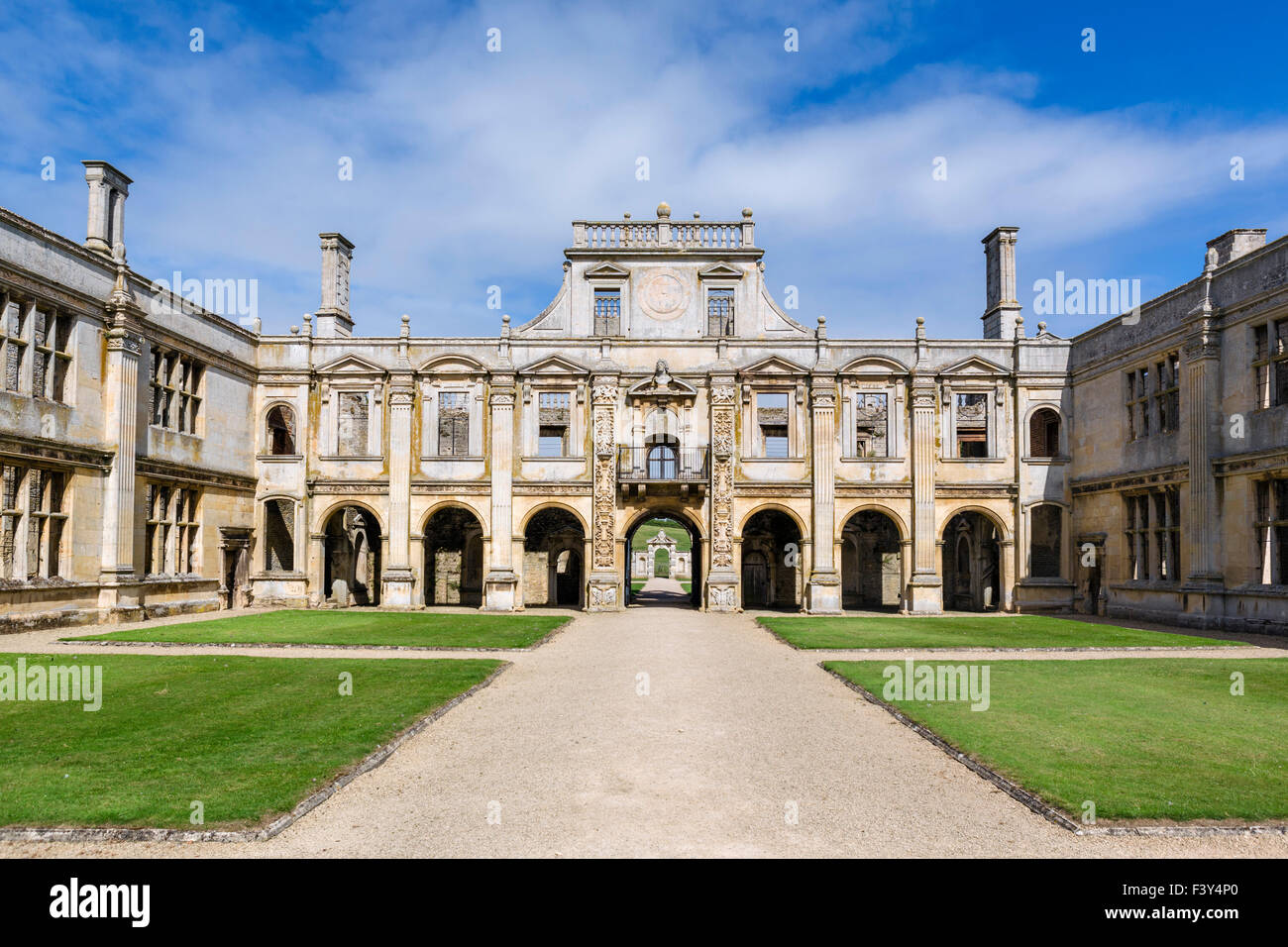 The inner courtyard looking towards the north front in Kirby Hall, a now ruined 16thC Elizabethan country house - Stock Image