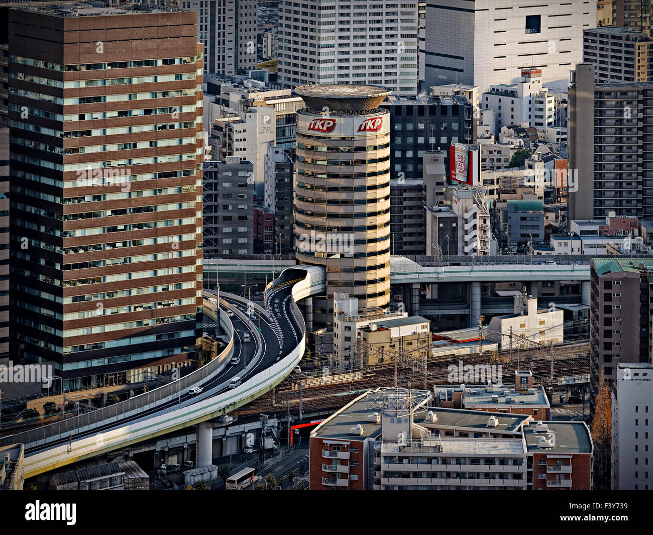 Japan, Honshu island, Kansai, Osaka, roads and buildings downtown. - Stock Image
