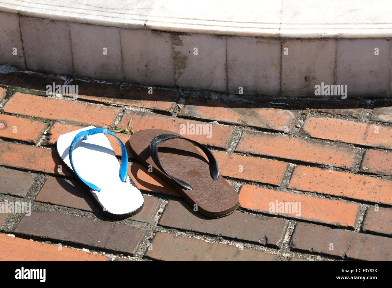 two different shoes used together as a pair - Stock Image