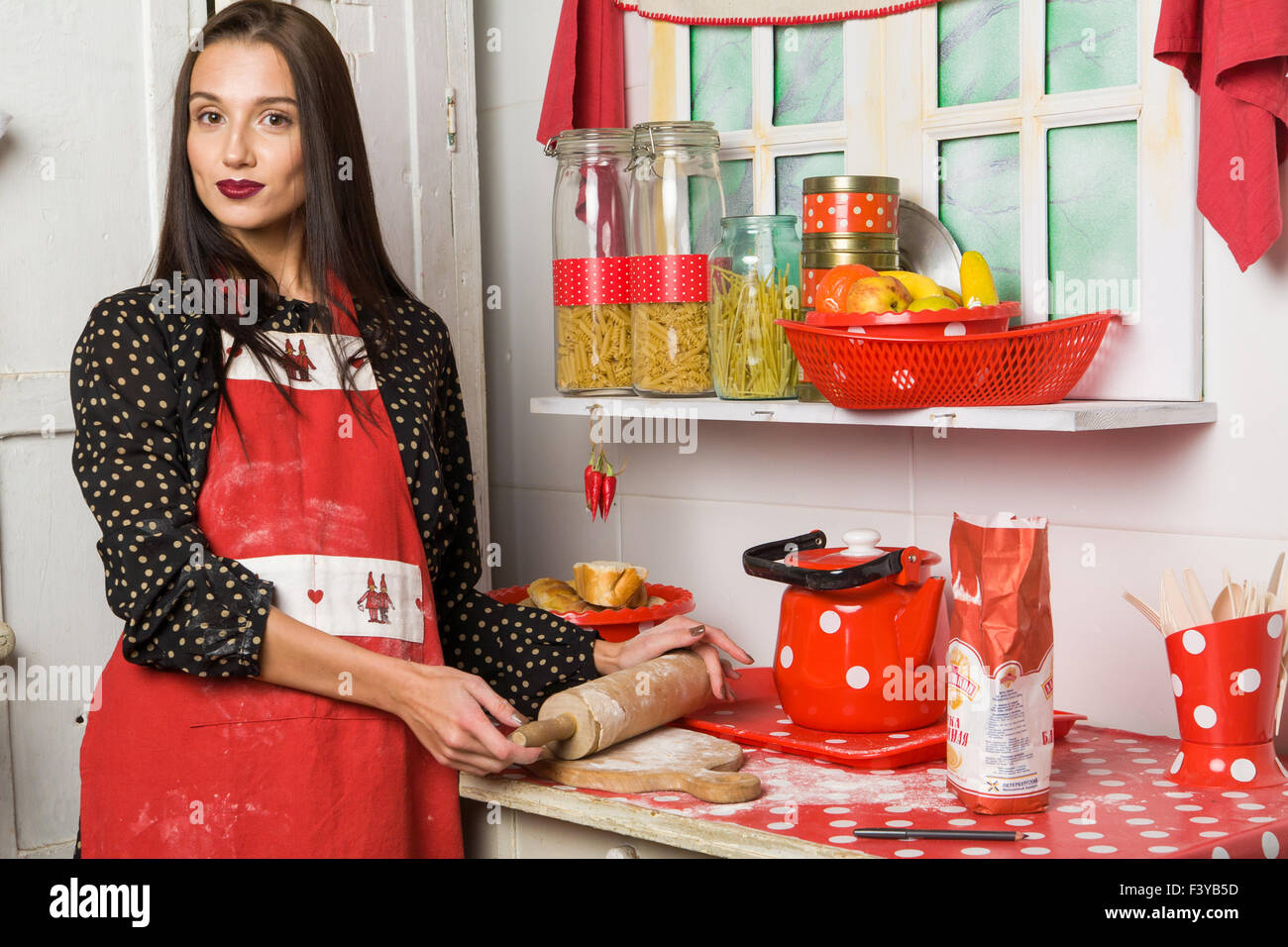 Housewife in the kitchen - Stock Image