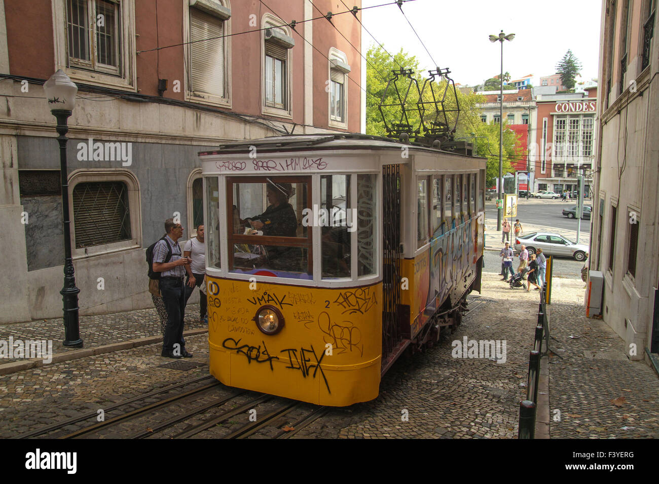 ​Lisbon, Portugal, 5 October, 2015. Tourists seen at Restauradores Square boarding a Glória Funicular. Credit: - Stock Image