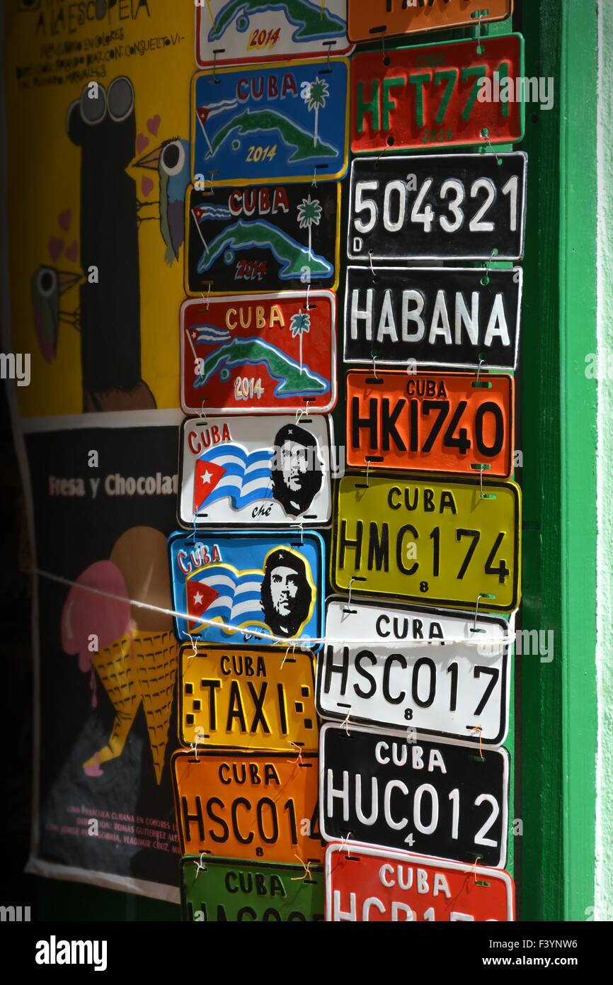 souvenir shop selling posters and colourful tourist number plates, Old Havana Cuba - Stock Image