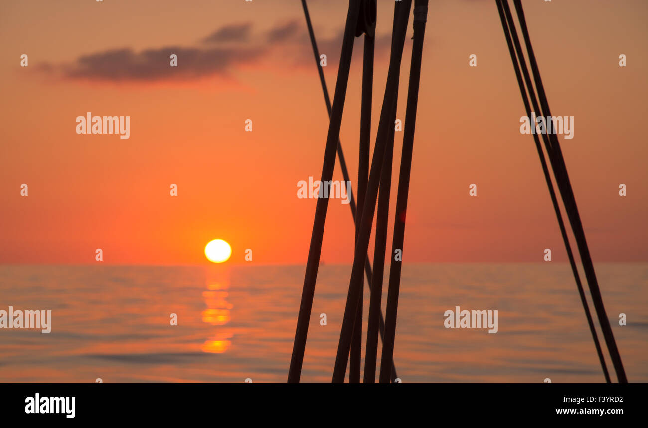 Sunrise On Boat And Dolphin Shape Cloud Stock Photo