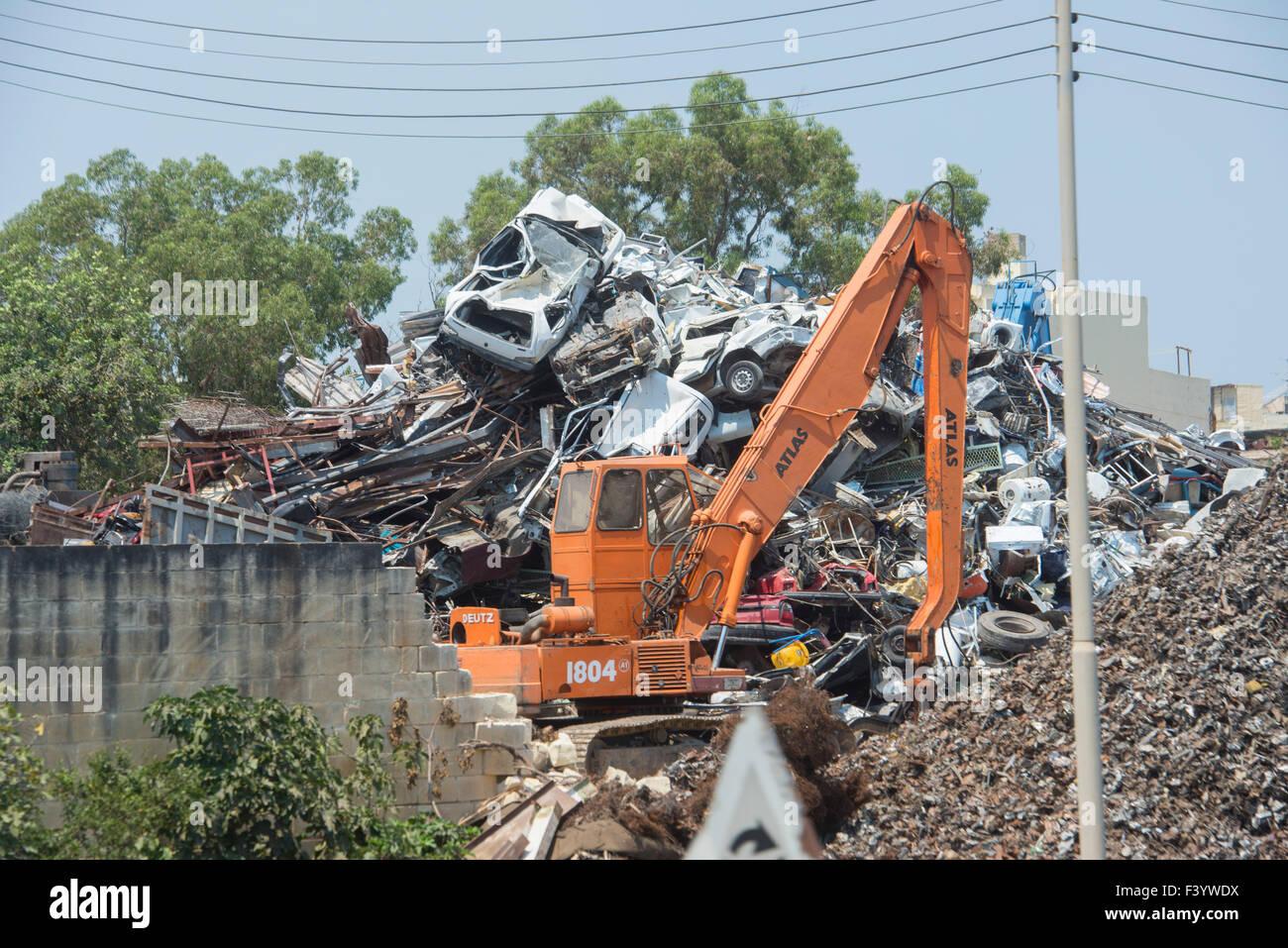 Crushed cars in scrap metal recycling yard in Malta. - Stock Image