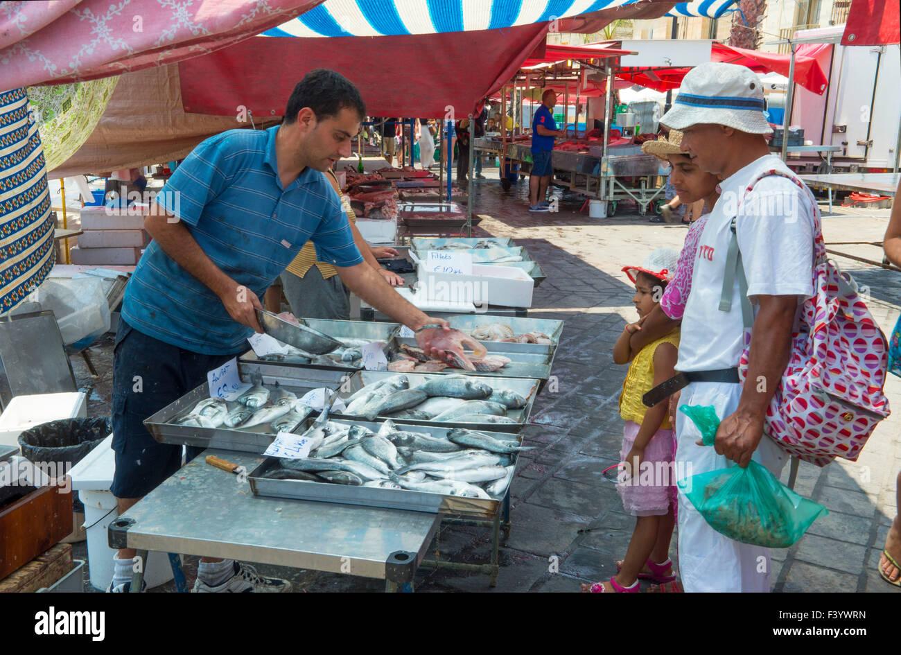 Fresh fish stall Marsaxlokk market Malta - Stock Image