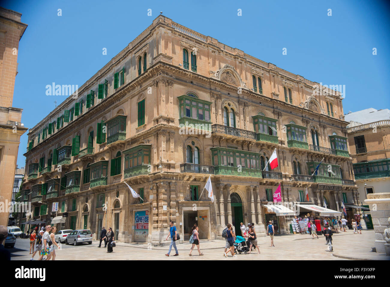 Palazzo Ferreria Valletta retail shops and fast food outlets in a once grand palace. - Stock Image